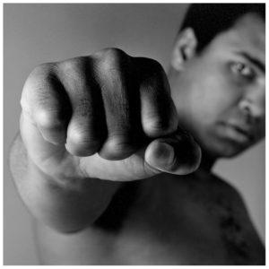 black and white image of muhammad ali punching towards the camera